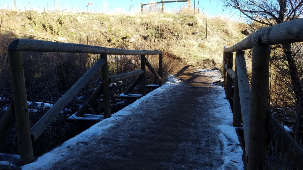 Wood foot bridge leading into White Ranch Park