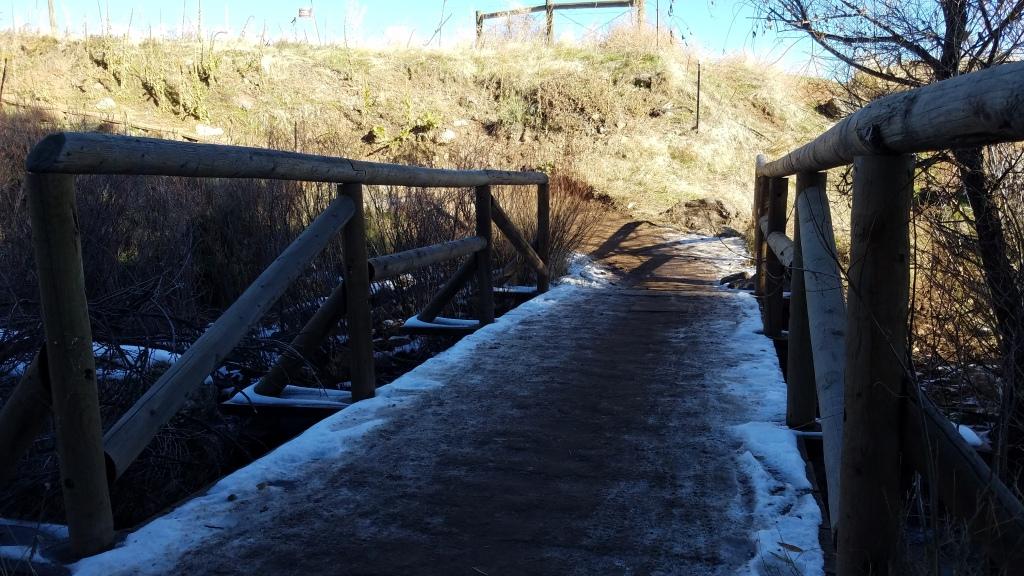 Wood foot bridge leading into White Ranch Park
