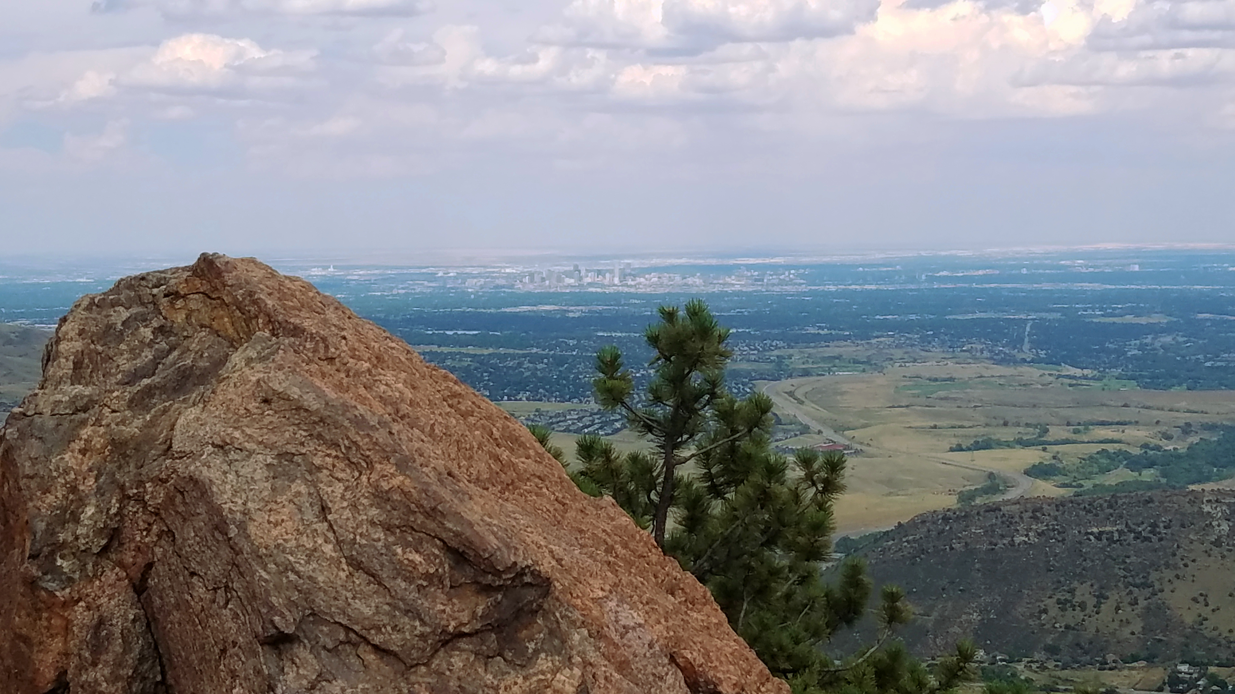 Views of Denver from a rocky perch in Mount Falcon Park