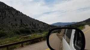 Side view mirror looking at Colorado river road near Lyons gulch free camping