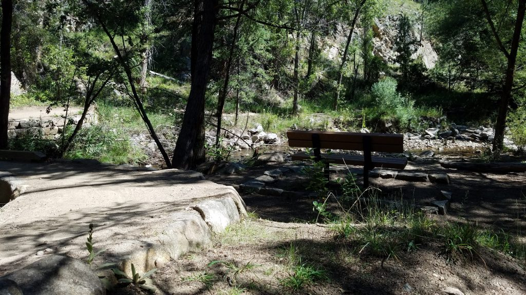 Bench by a creek in Betasso Preserve